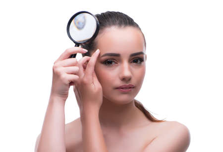 Woman in beauty concept with magnifying glass aging wrinkles Stok Fotoğraf