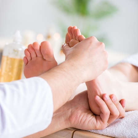 Foot massage in medical spa Banco de Imagens - 133505823