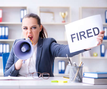 Angry businesswoman issuing termination notice