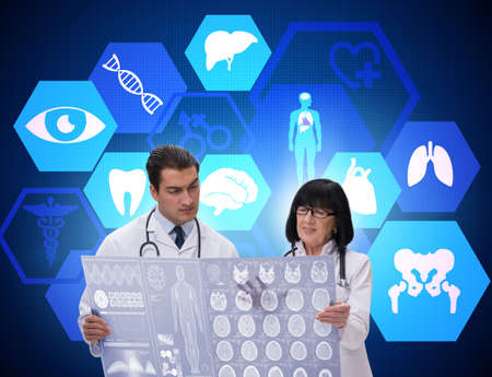 Two doctors discussing x-ray image in telemedicine concept Zdjęcie Seryjne