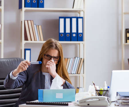 Businesswoman employee sick in the office