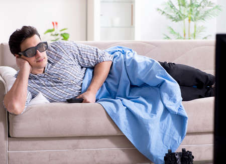 Man watching 3d tv at home