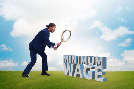 Concept of minimum wage with businessman Zdjęcie Seryjne