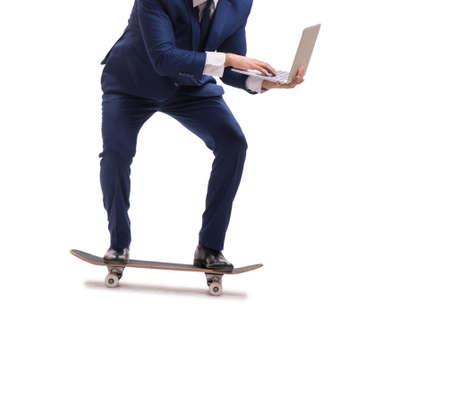 Businessman riding skateboard isolated on white background 免版税图像