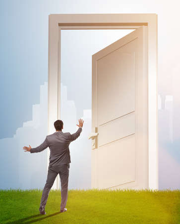 The businessman standing in front of door into future Stock Photo