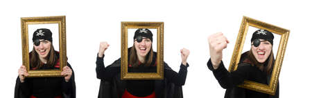 Female pirate in black coat holding photo frame isolated on whit
