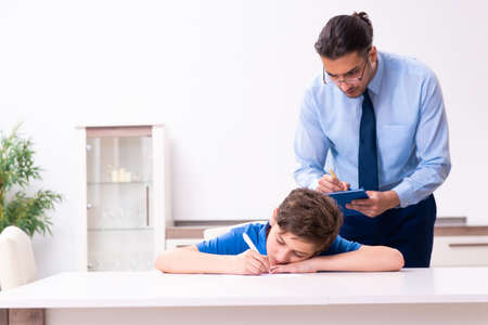 Busy father helping his son to prepare for exam