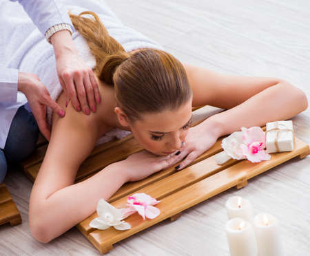 Young woman during spa procedure in salon Stock Photo