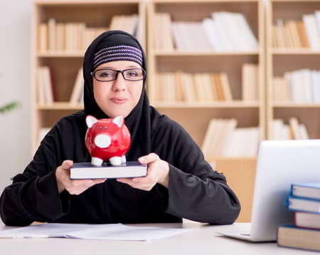 Muslim girl in hijab studying preparing for exams