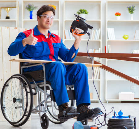 Disabled man working with circular saw Stock Photo