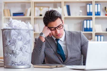 Businessman in paper recycling concept in office Stock fotó