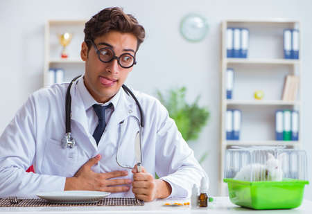 Mad crazy doctor preparing to eat rabbit 写真素材