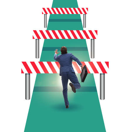 Businessman facing running barriers in challenging business