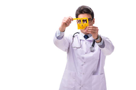 Young male doctor with goniometer isolated on white