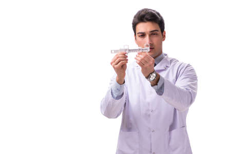 Young male doctor ophthalmologist isolated on white