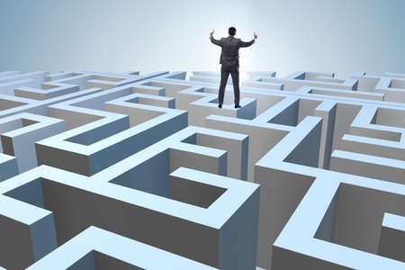 Businessman trying to escape from maze