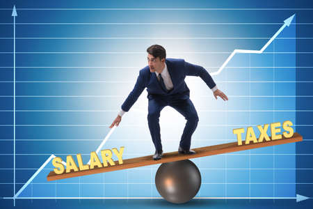 Businessman balancing between taxes and salary Stock Photo - 133124933