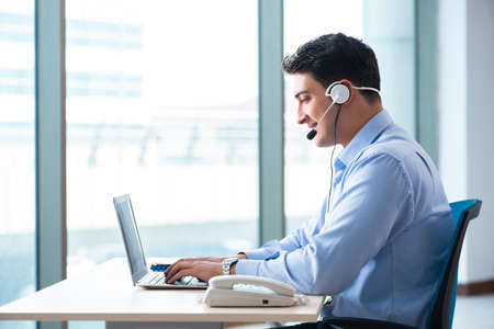 Male call-center operator in business concept