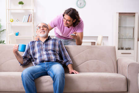 Young student and his old grandpa at home