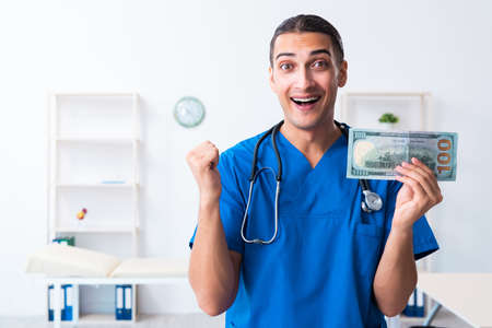 Young male doctor working in the clinic 版權商用圖片
