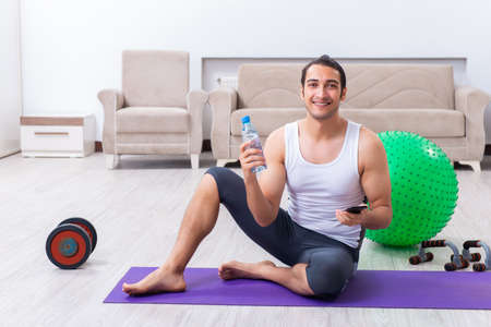 Young man training and exercising at home
