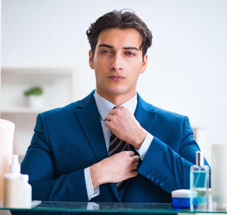 Man is getting dressed up for work in bathroom Zdjęcie Seryjne