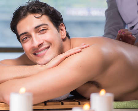 Young handsome man during spa procedure Stock Photo