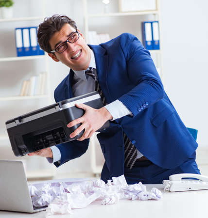Businessman angry at copying machine jamming papers