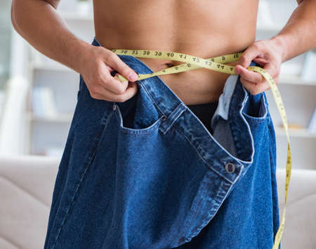Man in oversized pants in weight loss concept Archivio Fotografico - 133803575