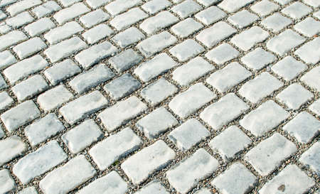 The road paved with cobble stones for your background