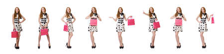 Young woman with shopping bags on white Reklamní fotografie