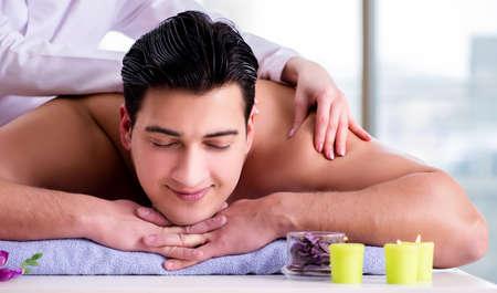 Handsome man in spa massage concept