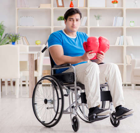 Disabled boxer at wheelchair recovering from injury 版權商用圖片