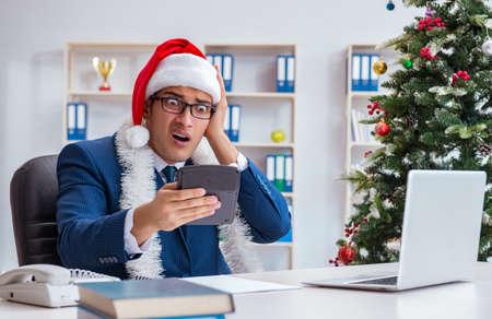 Businessman celebrating christmas holiday in the office Reklamní fotografie