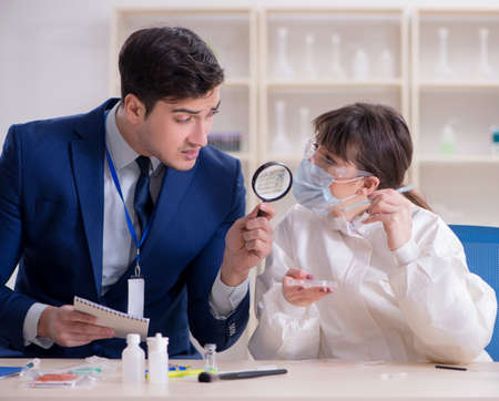 Expert criminologist working in the lab for evidence