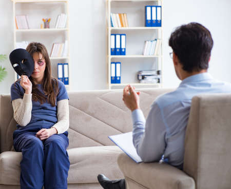 Woman suffering from home violence visiting doctor