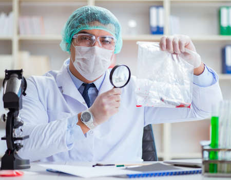 The forensics investigator working in lab on crime evidence Stock fotó