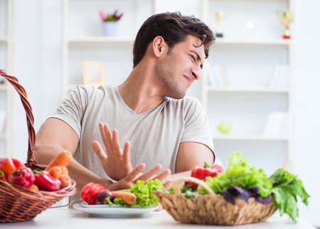 The young man in healthy eating and dieting concept