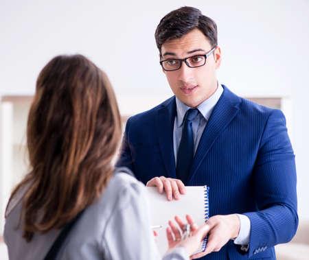 Real estate agent showing new apartment to owner Reklamní fotografie