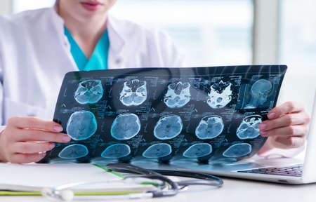 Doctor examining MRI image in hospital