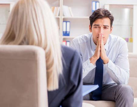 The young man visiting psychiatrist doctor for consultation Reklamní fotografie