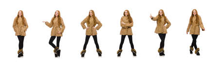 Redhead girl in fur coat isolated on white Standard-Bild - 134143747