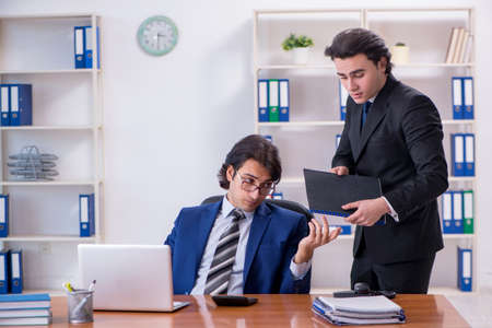 Boss and his male assistant working in the office