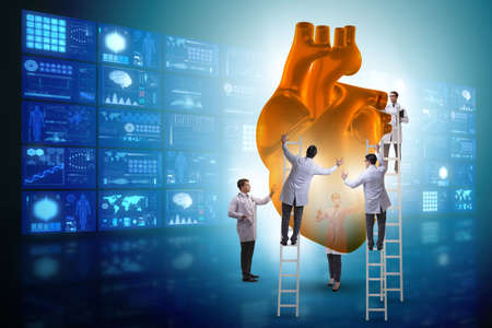 Heart examination by a team of doctors Stockfoto