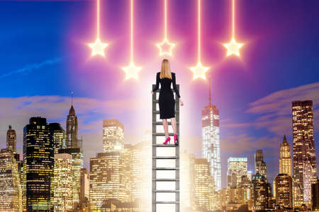 Businesswoman reaching out for stars in success concept