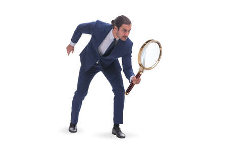 Businessman with giant magnifying glass 写真素材