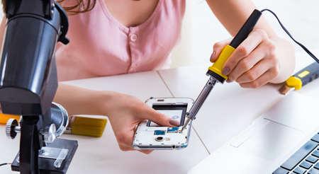 The mobile phone repair in workshop 스톡 콘텐츠