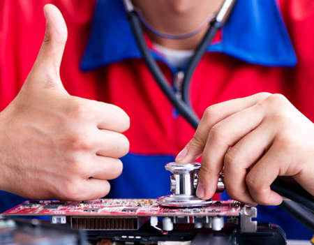 Repairman working in technical support fixing computer laptop troubleshooting