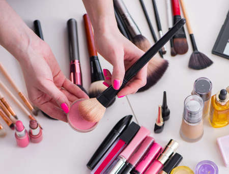 The collection of make up products displayed on the table 스톡 콘텐츠
