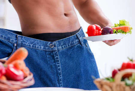 The young man in healthy eating and dieting concept Stock fotó